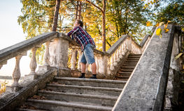 Man dreaming on stairs n forest Stock Image