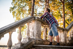 Man dreaming on stairs n forest Royalty Free Stock Images