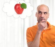 Man dreams about apple Royalty Free Stock Photo