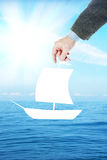 Man dreams to sail on a boat in the ocean Royalty Free Stock Photos
