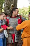 Man dressed in the armor of an ancient Russian warrior. The picture was taken in Russia, in the city of Orenburg, in the open air. At the festival `Legends of Stock Photo