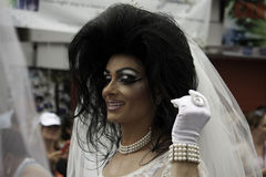 Man dressed as bride walking in the 35th Annual Provincetown Carnival Parade in Provincetown, Massachusetts. Royalty Free Stock Image