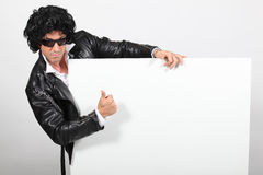 Man dressed as Elvis Royalty Free Stock Photos
