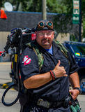 Man dressed as a Ghost buster. A man appears in the costume of a Ghost buster, at the Coloma Peach festival in Michigan Stock Photos
