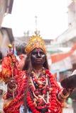 A man dressed as Goddess Kali Stock Image
