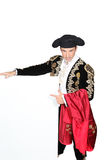 Man dressed as a matador. Man dressed as matador stood with blank message board Royalty Free Stock Image