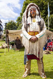 Man dressed as a native American Indian chief warrior. Staffordshire, England. - June 21st 2014 : Man dressed in the traditional costume of a Native American Royalty Free Stock Photography