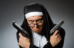 The man dressed as nun with handgun Stock Photos