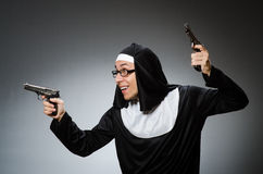 The man dressed as nun with handgun Royalty Free Stock Images
