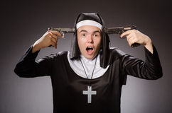 The man dressed as nun with handgun Royalty Free Stock Image