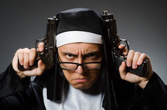 The man dressed as nun with handgun Royalty Free Stock Photo
