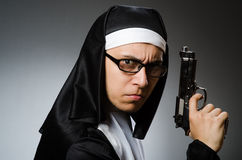 The man dressed as nun with handgun Stock Images