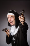 The man dressed as nun with handgun Stock Image