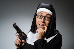 The man dressed as nun with handgun Royalty Free Stock Photos