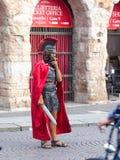 Man dressed as Roman legionary smokes near the Arena Stock Images