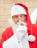 Man Dressed As Santa Claus With Finger On Lips Royalty Free Stock Photo