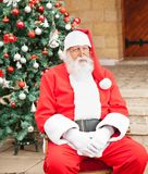 Man Dressed As Santa Claus Sitting In Front Of Stock Photography