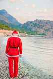 Man dressed as Santa Claus walks Royalty Free Stock Photos