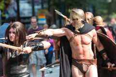 Man Dressed As Spartan Warrior Walks In Dragon Con Parade. Atlanta, GA, USA - September 5, 2015:  A muscular man dressed like a Spartan warrior from the movie Stock Photo