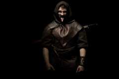 Man dressed in barbarian style with sword and moustache, bearded Royalty Free Stock Photo