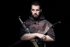 Man dressed in barbarian style with sword and moustache, bearded Royalty Free Stock Images