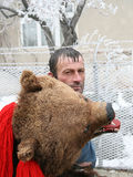 Man dressed in bear skin. At the Bear dance parade in eastern Romania stock photo