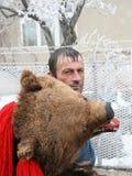 Man dressed in bear skin Stock Photo