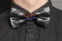 Man Dressed Black Shirt With Bow Tie with South Korean Flag. Closeup stock image