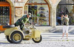 Man climbs into Vintage World War II Motorcycle & Sidecar royalty free stock photography