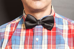 Man Dressed Checkered Shirt With Black Bow Tie Stock Photography