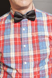Man Dressed Checkered Shirt With Black Bow Tie On Gray Stock Image