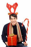 Man dressed for Christmas, wearing reindeer horns, Stock Photography