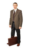 Man dressed in dark trousers and green coat Stock Photography