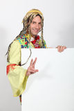 Man dressed in hippy costume holding message Stock Image