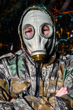 Man dressed into military wear and gas mask, ecology and toxic c Royalty Free Stock Photo