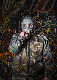 Man dressed into military wear and gas mask, ecology and toxic c Stock Image