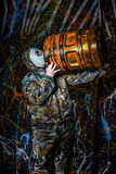 Man dressed into military wear and gas mask, ecology and toxic c Stock Photos