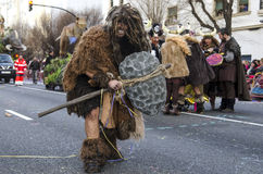 Man dressed Neanderthal. CADIZ, SPAIN-MARCH 02: man dressed Neanderthal in carnival parade Cadiz on march 02, 2014 in Cadiz Royalty Free Stock Image