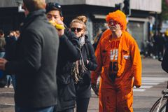 Man dressed in orange, crazy wig, King`s Day festivity. In the Netherlands, national holiday, important celebration, street festival Royalty Free Stock Photos