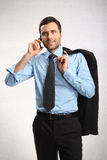 A man dressed in shirt. Handsome businessman wearing suit. He is talking on the phone Royalty Free Stock Photos