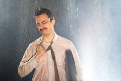 Businessman in the Rain. A man dressed in a shirt and tie looks sad because of big stress stock image
