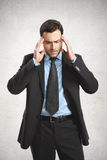 A man dressed in suit. Handsome businessman wearing suit. He has a headache Royalty Free Stock Images
