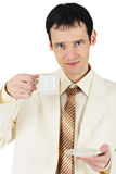 Man dressed in suit drinking tea Stock Photo