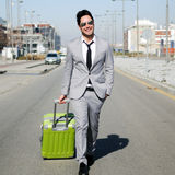 Man dressed in suit with a suitcase. Man dressed in suit and suitcase in the street Stock Photography