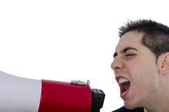Man dressed in suit and tie shouting through megaphone. Stock Photos