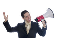 Man dressed in suit and tie shouting through megaphone. Royalty Free Stock Image