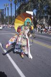 Man dressed in tie dye marching at the Doo Dah Parade, Pasadena, California Stock Photo