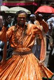 Traditional Dancer. A man dressed in a traditional dancing attire during a religious festival in India Stock Photos
