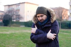 Man dressed in warm clothes feeling cold Stock Images