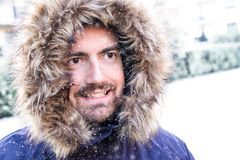 Face portrait of smiling man dressed with warm coat in cold seas Royalty Free Stock Photos